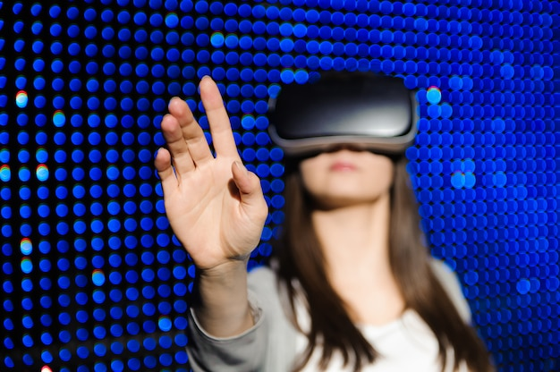 Young woman wear virtual reality digital glasses