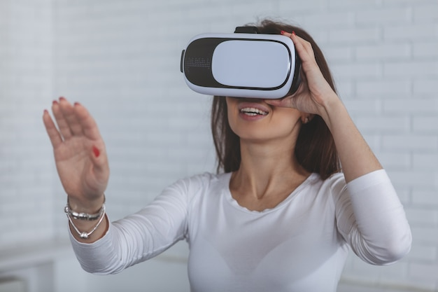 Young woman wearing 3d virtual reality glasses