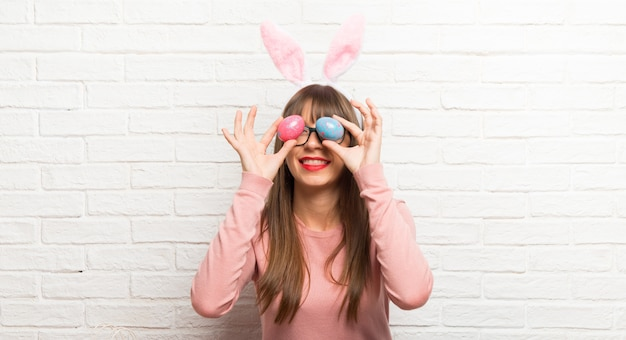 Young woman wearing bunny ears for easter holidays