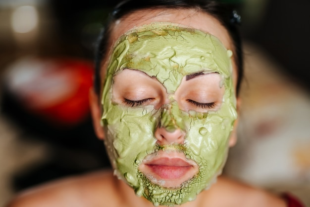 Young woman wearing a facial mask. skin care concept