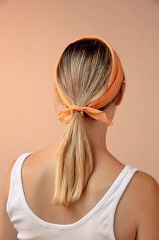 Young woman wearing a handkerchief as a hair accessory