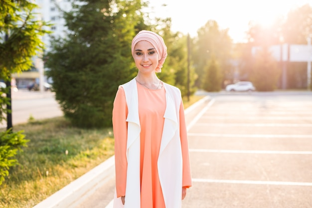 Young woman wearing hijab head scarf in city