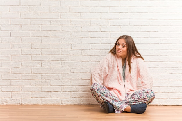 Young woman wearing pajama scolding someone very angry