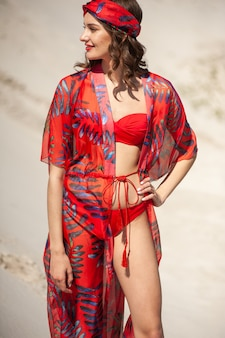 Young woman wearing red beach wear