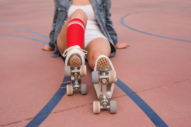 Young woman wearing roller skate relaxing on court