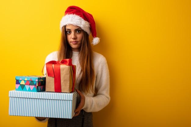 Young woman wearing santa hat celebrating christmas day