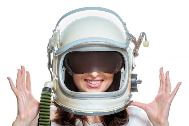 Космический шлем молодой женщины нося изолированный на белой предпосылке Premium Фотографии