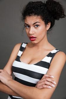 Young woman wearing striped shirt