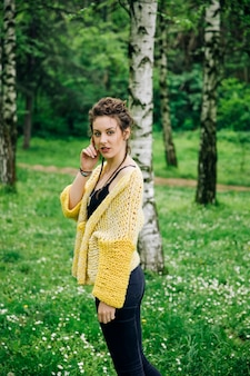 Young woman wearing sweater  and posing the park