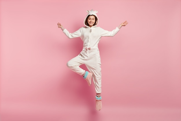 Young woman wearing unicorn pajamas
