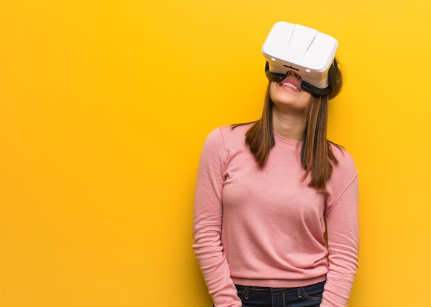 Young woman wearing virtual reality goggles