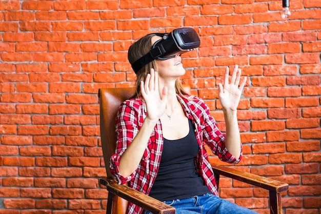 Young woman wearing virtual reality headset in studio
