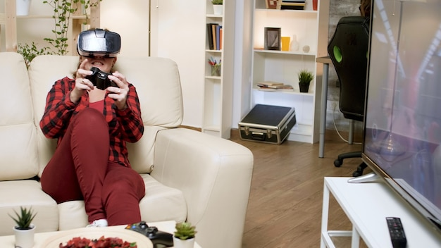 Young woman wearing vr headset while playing video games. boyfriend sitting on gaming chair.