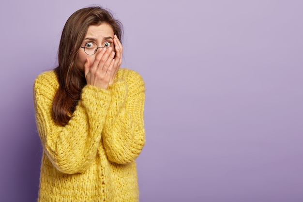 Young woman wearing yellow sweater