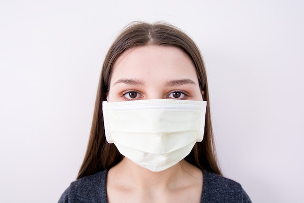 Young woman wears a face mask.