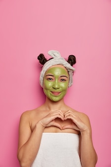 Young woman wears natural facial mask skin treatments after taking bath