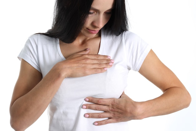 Young woman will feel pain in chest area closeup