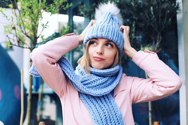 Young woman in the winter with knitted hat and scarf