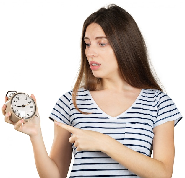 Young woman with alarm clock isolated on white. time management concept