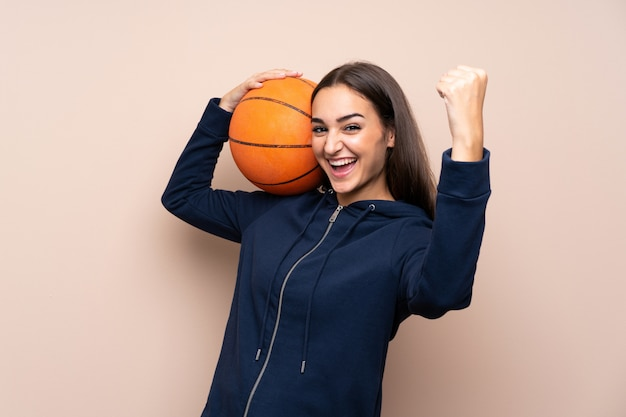 Young woman with ball of basketball