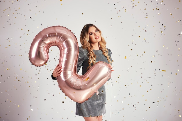 Young woman with balloons in two shape