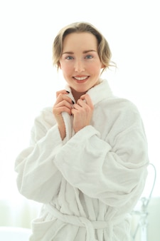 Young woman with bathrobe after shower