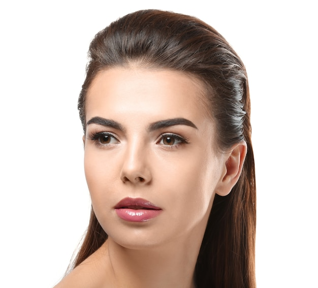 Young woman with beautiful eyebrows on white