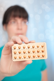 Young woman with birth control pills