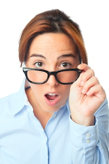Young woman with black glasses looking surprised