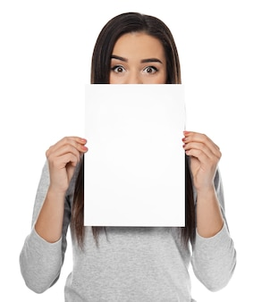 Young woman with blank sheet of paper for advertising on white background
