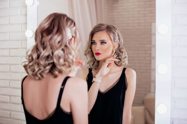 Young woman with blonde hairstyle and makeup