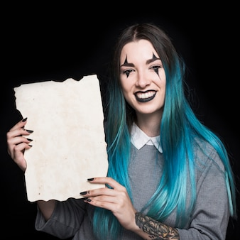 Young woman with blue hair holding paper