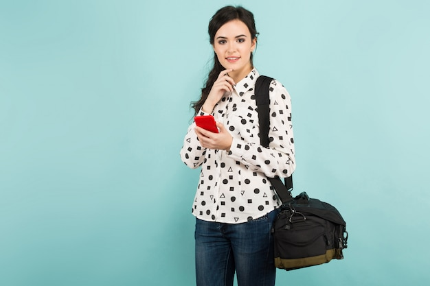Young woman with camera and its case