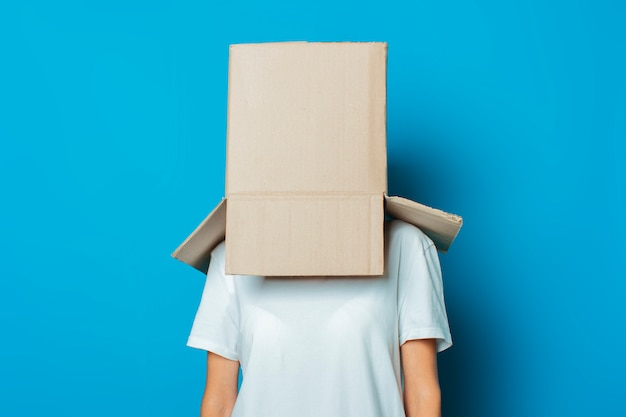 Young woman with a cardboard box on her head