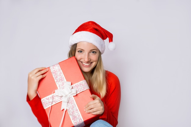 Young woman with christmas present.