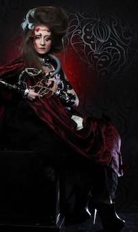 창의적인 메이크업으로 젊은 여자. 할로윈 테마입니다. 좀비 테마입니다.
