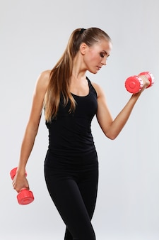 Young woman with dumbells