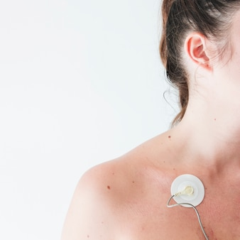 Young woman with electrode on body