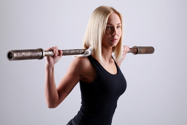 Young woman with exercise bar