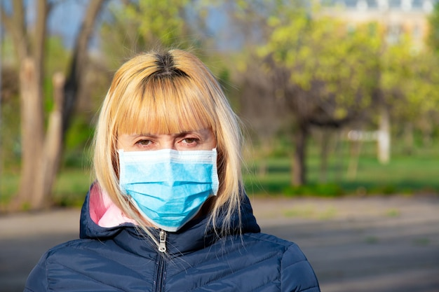 Young woman with face mask on the street. novel chinese coronavirus concept of self-protection