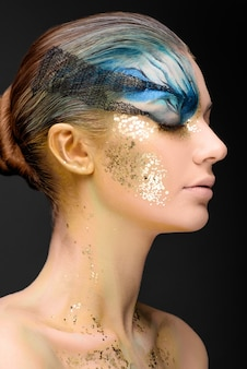 Young woman with fantasy make up