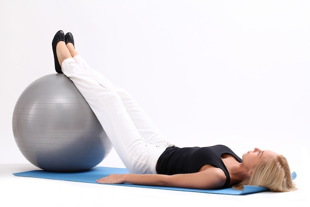 Young woman with fitness ball