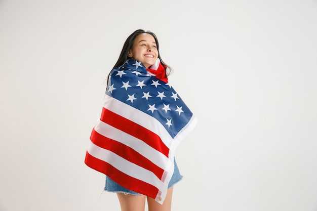 Young woman with the flag of united states of america