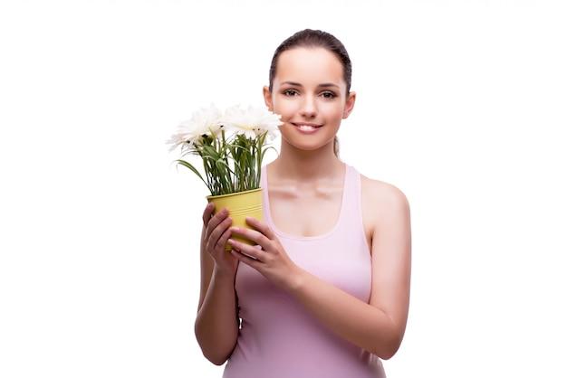 白で隔離される植木鉢を持つ若い女