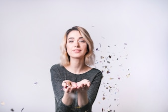 Young woman with flying confetti
