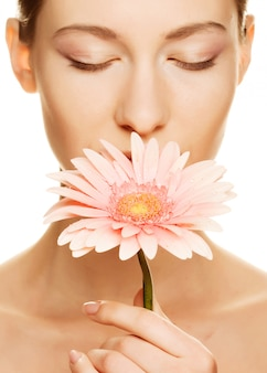 Young woman with gerber flower