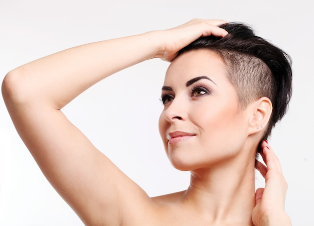 Young woman with haircut and evening makeup