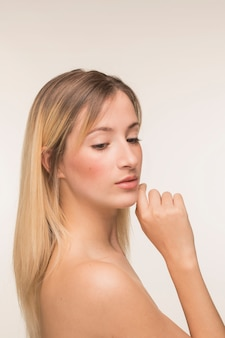 Young woman with hand on the chin pose