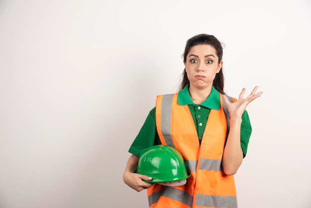 Young woman with hard hat and wearing uniform. high quality photo