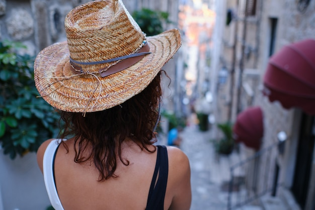 A young woman with hat in the streets of old town dubrovnik, croatia